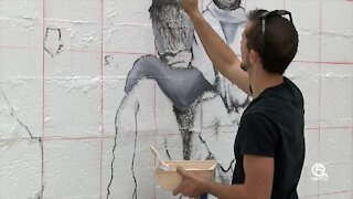 Artist revitalize historic Unity Wall in Lake Worth Beach