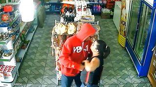Shopper bravely fights off gun-wielding robber