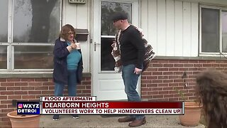 Volunteers rush to offer help to local flood victims in Dearborn Heights
