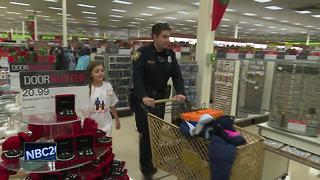 Kids shop with cop