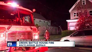 Crews battle house fire near Broadway and Fillmore Avenue