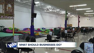 Businesses react to state mandate to close