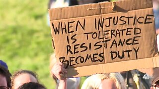Police, protesters march for unity