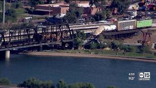 Train derails, causing fire and partial Tempe Town Lake bridge collapse