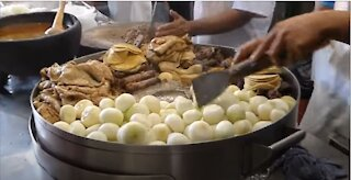 Massive batch of tacos being prepared for tourists in Patzcuaro, Mexico