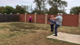 Gender Reveal Football Kicked Straight Into Neighbor's Yard