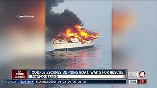 Couple escapes burning boat, awaits rescue