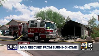 Valley man rescued from burning home