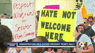 Protesters denounce President Trump outside Cincinnati rally