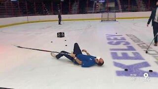 Sports Anchor Caleb Noe tries to play hockey, slips on ice
