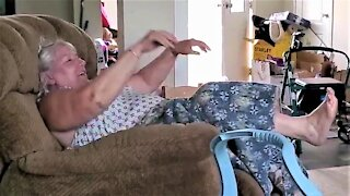 Daughter is in stitches as her mother fights with reclining chair