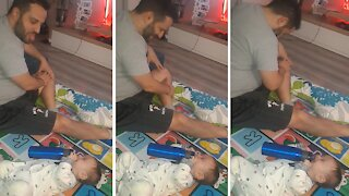 Baby breaks out into hysterical laughter when dad sticks his tongue out