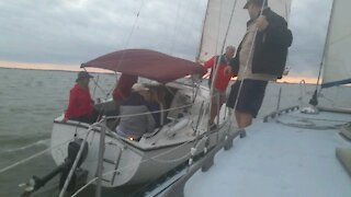 Crew exchange between boats under sail