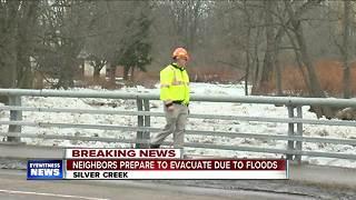 Neighbors of Silver Creek prepare for potential flooding evacuations