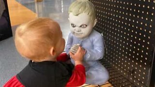 Toddler not spooked by creepy Halloween dummy