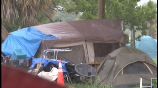 John Prince Park inhabitants wait for emergency shelter amid storms, flooding