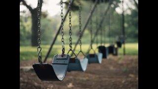 Toddler slips up on play swing