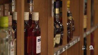 What makes a liquor store 'essential' business?