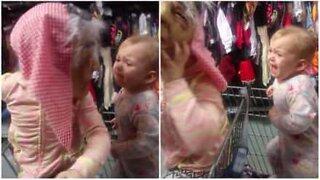 Little girl is frightened of Halloween masks