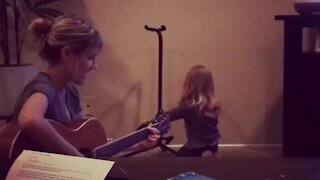 Little girl with angelic voice sings with her mommy