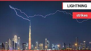 Moment the Burj Khalifa is struck by a huge lightning bolt