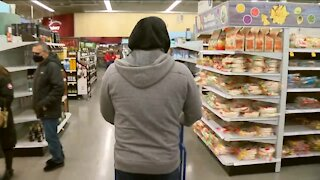 Last minute shoppers search for Christmas gifts
