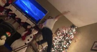 Warning: decorating the Christmas tree can be dangerous!