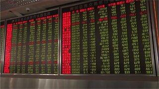 Wall Street dips as Trump threatens to increase Chinese tariffs