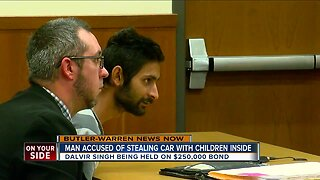 Bond set for man accused of stealing car with kids inside
