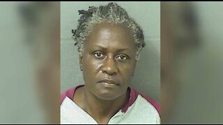 Woman charged with throwing hot water on worker