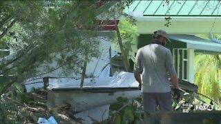 Crews work to remove plane crash debris