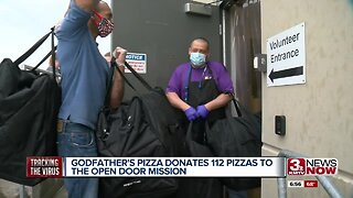 Godfather's Pizza donates pies to Open Door Mission