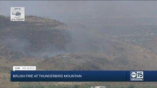Brush fire burning on Thunderbird Mountain