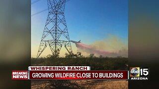 Fire crews battling wind-fueled brush fire near Wittmann