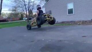 Dude crashes go-kart into friend's brand new car