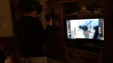 Girl tries out VR game, crashes into TV stand