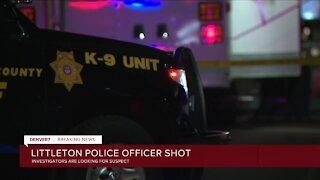 Littleton police officer shot, manhunt underway for suspect