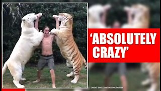 Men with two tigers