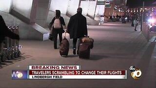Travelers scrambling to change their flights