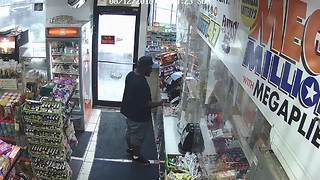 Suspect caught on camera after stealing woman's purse from Detroit gas station