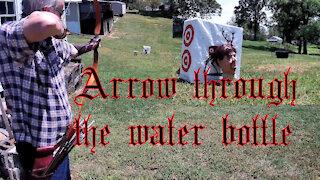 Arrow through the water bottle