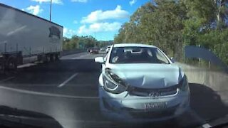 Distracted driver crashes into car
