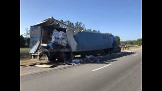 Truck driver crashes into stationary truck