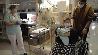 Newborn baby helps father with adorable surprise proposal at Cleveland Clinic