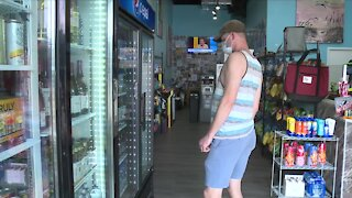 Delray Beach business owner says 'almost' everyone wearing masks
