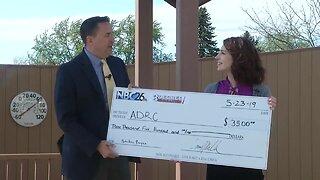 3 Degree Guarantee presents check to ADRC