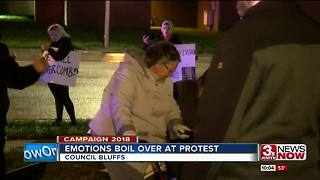 Protesters gather outside President Trump's rally in Council Bluffs