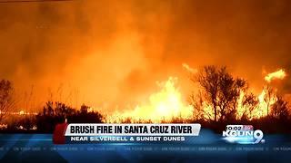 Brush fire burning in Santa Cruz River