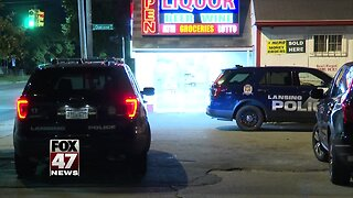 Liquor store robbed at gunpoint in Lansing