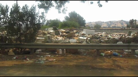 An Illegal Dump And Homeless Encampment Along Monterey Highway City of Coyote (Problem Still Exists Even After Clean Up By City of San Jose)